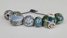 Set beads steampunk . The set consists of 4 porcelain beads and 2 bead-steampunk . By Mª Carmen rodriguez ( Majoyoal ) https://www.facebook.com/groups/CeramicArtBeadMarket