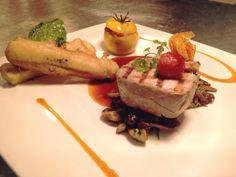 Seared tuna, wild mushroom fricassée, tempera zucchini, nicoise-stuffed yellow tomato and smoked tomato beurre blanc