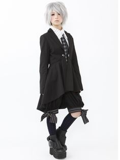 Bows at the bottom of the shorts, hooray! And combining the long coat with a very business like tie is pretty well done
