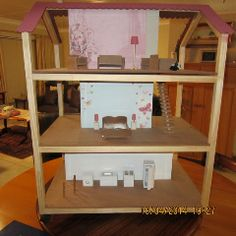 Collapsible Dolls House complete with furniture. From George, South Africa. Ben.engelbrecht@serendipity.org.za