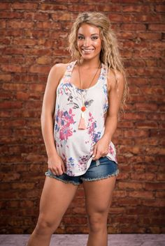 Fresh Flowers Tank, Ivory || This flower print is fresh and fab! The colors are beautiful and they pop so nicely against that ivory background. This tank will be great from spring through summer! In the spring wear it with a cardi or blazer and in the summer trade the warm layers for a bralette! Spring Wear, Spring 2016, Shopping Day, Fresh Flowers, Floral Tops, Ivory, Blazer, Tank Tops, Tees