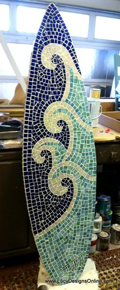 Mosaic surf board....way cool.....but seems like it would be slippery