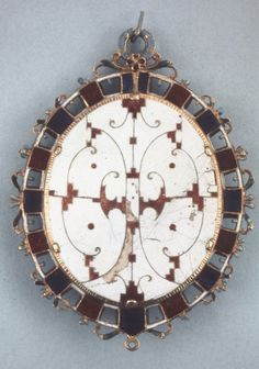 The Lyte Jewel;  back. Gold pendant jewel containing a portrait miniature of James I. Front: At the top of the oval frame is a pendant loop enamelled in opaque light blue, & at the bottom of the frame is a smaller pendant loop (originally enamelled on the front but no traces of colour remain). An openwork appearance has been created by piercing both the outer frame & the hinged cover. The frame consists of sixteen table-cut diamonds in rectangular gold collets alternating with sixteen…