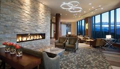 Sparkling Hill Resort (Vernon, Canada): Warm up in the Fireside Lodge after a day skiing or snowshoeing in the Monashee Mountains. Barn Bedrooms, Fireplace Seating, Fireplace Set, Wellness Resort, Hills Resort, Villa, Booth Seating, Office Space Design, Lobby Design
