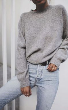 Gray sweater with blue jeans.