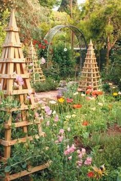 Garden obelisks, or tuteurs, draw the eye upward and offer support to twining plants such as pole beans, sweet peas and cucumbers. These structures can also be built of metal or constructed of branches.