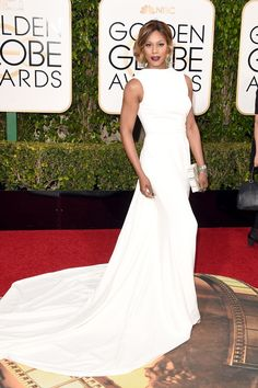 Laverne Cox stuns in a white gown with train by Elizabeth Kennedy.   - TownandCountryMag.com