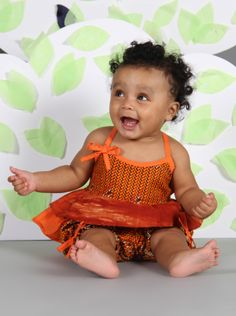 Ootsey Cutesey- Ootsey Cutsey is just that, too cute. This is a 2 peice summer top and shorts set with lovely detailing. Made with 100% cotton in mixed African prints.