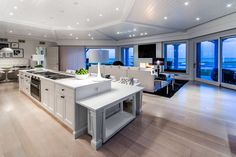 <p>The main residence features an open-concept layout. Here is the ultra-modern living room, which has retractable walls that reveal the property's outdoor oasis. (Joseph Montanaro / Sotheby's International Realty Quebec) </p>