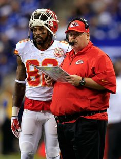 INDIANAPOLIS, IN - JANUARY 04: Wide receiver Dwayne Bowe #82 and head coach Andy Reid of the Kansas City Chiefs look on during a Wild Card Playoff game against the Indianapolis Colts at Lucas Oil Stadium on January 4, 2014 in Indianapolis, Indiana. (Photo by Rob Carr/Getty ...