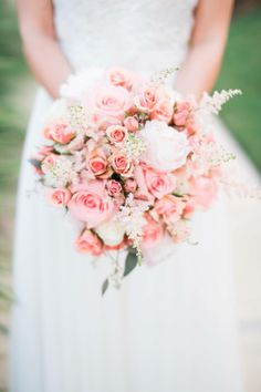 Peach and pink bridal bouquet with roses, astilbe and peonies. Photo by: Lindsey Mueller Photography