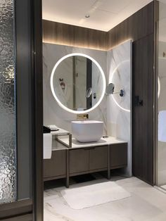 Modern bathroom with cool illuminated mirror