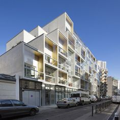 Apartments appear to be stacked up like boxes at this concrete housing block in Paris.