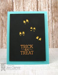 handmade Halloween card from Lil' Inker Designs ... black panel with die cut out yellow eyes ... simple sentiment ... turquoise frame ... great card!