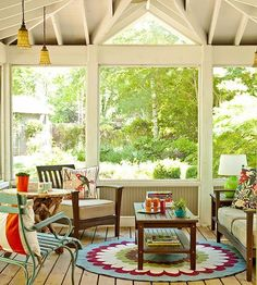 Screen a porch so pesky bugs stay out, and the cool summer breeze can still come in. A screened porch makes a great place to have dinner when the weather allows. The screens still let the sunshine pour in and don't distract from great views. Add indoor touches, like a pendant, to an outdoor space to make it feel more homey and decorated.