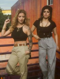 Early 90's Chola street / fashion. I sported this look with the metal letter belts though.  G;)