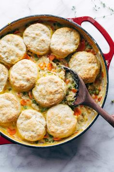 Chicken Pot Pie with Biscuits! Sautéed shallots and thyme, a splash of white wine, creamy chicken, peas, and carrots all baked under a homemade biscuit topping Biscuit Chicken Pot Pie, Homemade Biscuits, Homemade Breads, Cooking Recipes, Healthy Recipes, Frozen Peas, Creamy Chicken, Entrees, Food Print