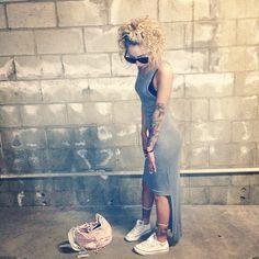 Lil Debbie...  that curly hair + that maxi & crisp white chucks....