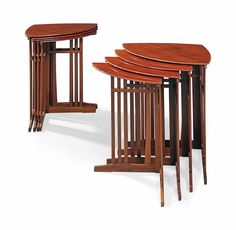 TWO SETS OF ART NOUVEAU MAHOGANY QUARTETTO TABLES BY GUSTAVE SERRURIER-BOVY, 1905 29½ in. (75 cm.) high; 27½ in. (70 cm.) wide; 19½ in. (49.5 cm.) deep and smaller (8)