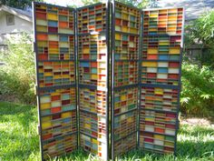 Colorful folding screen made from typeset drawers.