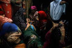 Relatives mourn Shahnawaz Mir, leader of the Kashmir rebel group Mujahadeen, in Tral, India. July 2, 2013.