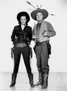 Bob Hope and Jane Russell pose with their guns raised in a scene from the 1948 film 'The Paleface.' Jane Russell as Calamity Jane enabled Bob Hope to turn eastern dentistry into western heroism in the film.  (AP Photo/Paramount)