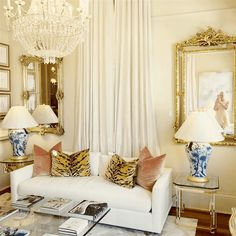 Channeling Grace Kelly - A Rising Interior Design Star - laurel home | The gorgeous shop of Rivers Spencer | #NeverGoHome | Adore this wonderful living room vignette #Chinoiserie Lamps - Ralph Lauren | Tiger pillow fabric - Clarence House | can't take my eyes off of that magnificent crystal chandelier and silk draperies!