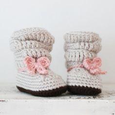 Now your baby girl can have a pair of slouch boots for the winter!    These baby slouch booties are crocheted in a light grey/oatmeal and set off with