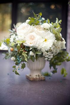 White vase, beautiful bouquet.
