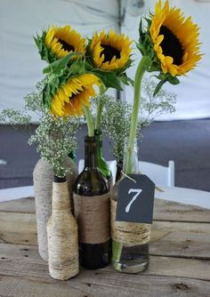 FurnitureGlamorous Wine Bottle Centerpieces That Compliments Every Event Under Dollars Unique Twine Wrapped Sunflowers Comely Decorated Wine Bottles Xmas Bottle Centerpieces For Wedding Reception Decorations Under 50 Dollars Sunflower Wedding Centerpieces, Summer Centerpieces, Wedding Reception Centerpieces, Wedding Sunflowers, Wedding Table, Italian Centerpieces, Sunflower Decorations, Graduation Centerpiece, Quinceanera Centerpieces