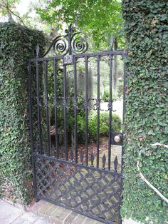 A creeping fig-covered gate in the city which is well-known for its beautiful architectures, gardens, gates, and fences Wrought Iron Garden Gates, Garden Gates And Fencing, Metal Gates, Garden Doors, Fence Gate, Front Gates, Entrance Gates, Tor Design, Old Gates