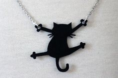 shrink plastic cat necklace?
