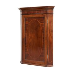 This is an elegant Georgian mahogany corner cabinet, made in about featuring a front with an oval of figured veneer, bordered with box wood stringing Retro Furniture, Antique Furniture, Mid Century Furniture, Georgian, Armoire, Traditional, Cabinet, Antiques, Corner
