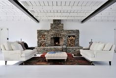 Take a look at some examples of fireplace features in these white Swedish interiors. For instance, against a clean white backdrop, we love how the grey stone fireplace becomes. Decorative Stone Wall, Rustic House, Inspired Homes, Fireplace Design, Swedish Interiors, Stone Fireplace Designs, Fireplace, Cozy Fireplace, Stone Decor