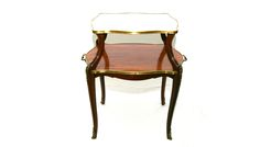 An elegant and polite walnut serving table with marble top and brass mounts.                                                                                                                                                                                                                                                                                                                        C.1900 French.