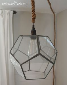 My craft room could su… DIY- Glass Geo Terrarium Turned Light Fixture, cute idea. My craft room could sure use a light and i have just the right one for it. Geometric Pendant Light, Diy Pendant Light, Orb Light, Pendant Lights, Hanging Light Fixtures, Hanging Lights, Diy Chandelier, Chandeliers, Terrarium Diy