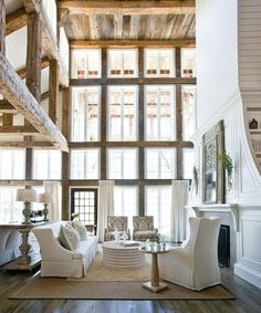 I am so in love with the use of raw wood here! And of course the high windows!
