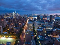 A view looking out across the High Line, 10th Avenue, and the New York City skyline. Photo by Timothy Schenck