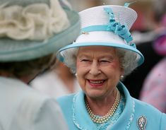 Queen Elizabeth hosts a garden party at Buckingham Palace in July 2011