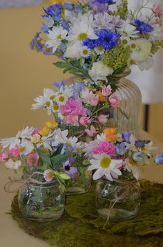 Very inexpensive preserving jars and large biscuit barrel turned into vases for a country style wedding