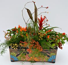 Thanksgiving centerpiece in Talavera Pottery.  Ornamental peppers, dried okra…