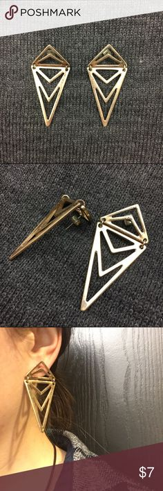 Edgy gold triangle earrings These are really cool gold colored triangle earrings with hinges connecting the triangles. They add a modern and edgy look to any outfit, and especially pop when paired with all black! Jewelry Earrings