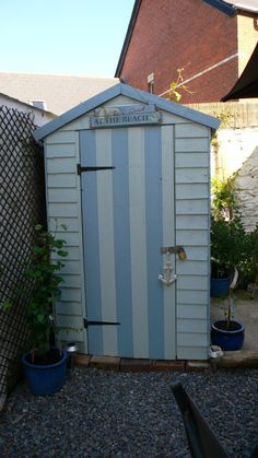 Great idea for a shed - turn it into a beach hut - much less of an eyesore Seaside Garden, Coastal Gardens, Beach Gardens, Outdoor Gardens, Beach Theme Garden, Beach Hut Shed, Beach House, Painted Shed, Seaside Theme
