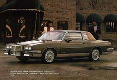 83' Pontiac Grand Prix...mine was blue With quarter white vinyl top!