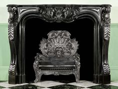 Antique French black marble Louis XV rococo fireplace mantel.✖️Art And Ideas ➕More Pins Like This At FOSTERGINGER @ Pinterest ➖