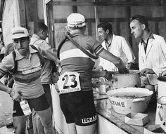 Riders replenish their water bottles during the Tour de France July 1951 @gettyimages
