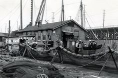 A familiar scene on the docks: mending nets, 1930. Courtesy Washington State Archives, Puget Sound Branch.