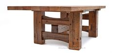 Massive reclaimed barn wood beams and timbers are used in this beautiful Timber Frame Barn Wood Beam dining table. The wood's beautiful distressed texture will add warmth, character and rustic charm to any atmosphere. Exposed joints emphasize the table's traditional barnwood origins. Notice the massive barn wood beam connecting the two trestle bases - this