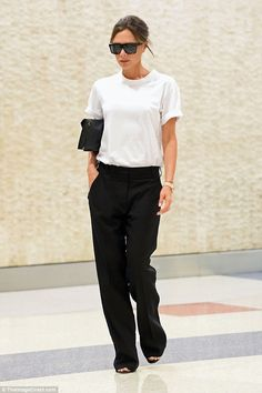 High-flier: Victoria Beckham was back to her bare-faced best on Wednesday, as showcased her natural beauty with minimal make-up while arriving at JFK airport in New York