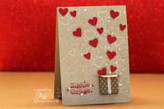 handmade Valentine card ... glittery red hearts floating out of  a dimensional box ... splats & whide outline hearts on kraft ...